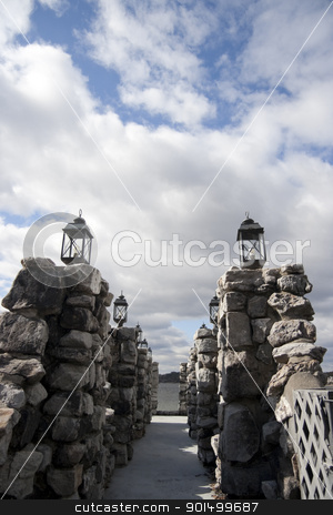 Pier stock photo, A pier made out of stone and with black lights on the edge. by Kevin Tietz