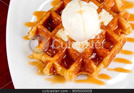 Waffle and ice cream stock photo, Tasty waffle and ice cream with cream by olinchuk