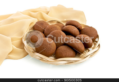 Gingerbread in a wicker tray stock photo, Brown gingerbreads in a wicker tray, yellow fabric isolated on white background by rezkrr