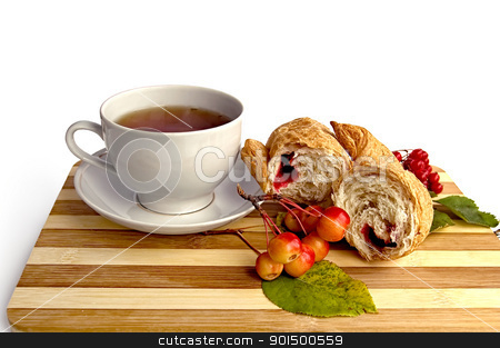 White cup and a croissant on the board stock photo, Tea in a white cup, broke a croissant with jam, a sprig of wild apples, viburnum with leaves on a wooden board isolated on white background by rezkrr