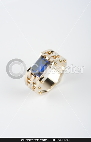 gold ring stock photo, gold ring with big blue gem and smaller diamonds by olinchuk