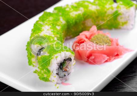 sushi rolls stock photo, Sushi rolls made of salmon, avocado, flying fish roe - tobiko caviar and philadelphia cheese by olinchuk