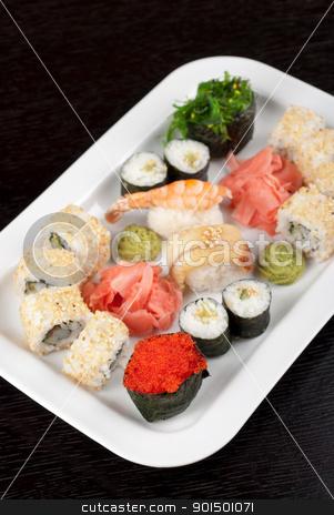 sushi set stock photo, japanese sushi set with red tobiko sushi in the foreground by olinchuk