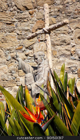 Father Serra Statue Mission San Juan Capistrano Church Ruins Cal stock photo, Father Serra Statue Bird of Paradise Flower at Mission San Juan Capistrano Church Ruins California. Statue is of Father Junipero Serra, who founded the Mission in 1775.  Church was destroyed in 1812 by earthquake. by William Perry