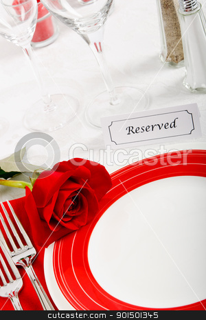 Romatic Restaurant Place Setting stock photo, A romantic red and white place setting shows a reserved table at an elegant restaurant ready to celebrate an anniversary or Valentines Day. by Karen Sarraga