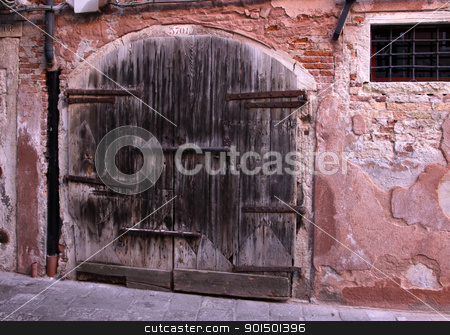 Very Old Large Wooden Door stock photo, A very old large wooden double door with a large lock. by Chris Hill