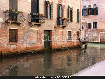 Venice Balconies stock photo, A canal in Venice, Italy, lined with a building with overlooking balconies. by Chris Hill