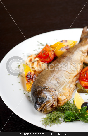 trout fish stock photo, trout fish baked with pepper, string beans, tomato and cauliflower by olinchuk
