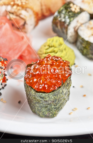 sushi set stock photo, japanese sushi set with red caviar sushi in the foreground by olinchuk
