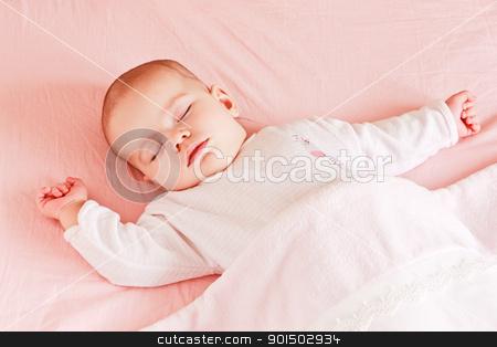 Sleeping baby girl stock photo, Sleeping baby girl in bed under blanket by Oleg
