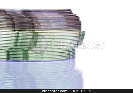 CD / DVD Stack stock photo, Close up view of a CD/DVD stack on a mirror by ruigsantos