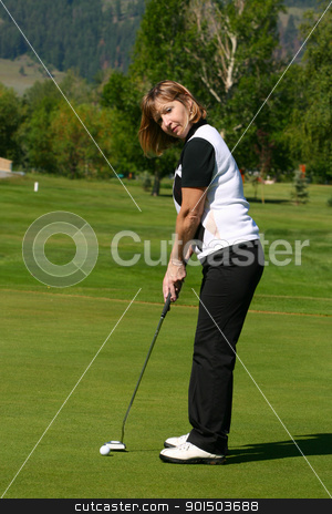 Putting stock photo, Adult female golfer putting on the green by Vanessa Van Rensburg