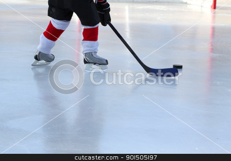 Pond Hockey stock photo, Legs of young child playing outdoor pond hockey by Vanessa Van Rensburg