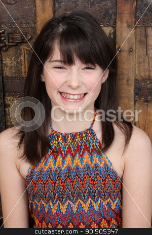 Teen stock photo, Beautiful brunette teen against a wooden background by Vanessa Van Rensburg