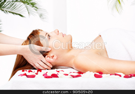 head and temple massage stock photo, Pretty woman on head, temple, massage treatment in salon by iMarin
