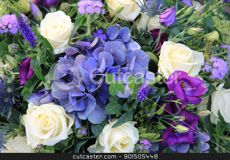 Flower arrangement with blue hydrangea, white roses and ivy stock photo, Flower arrangement in blue and white with hydrangea and roses by Porto Sabbia