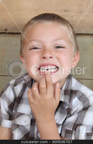 Missing tooth stock photo, Cute blond boy showing his missing tooth by Vanessa Van Rensburg