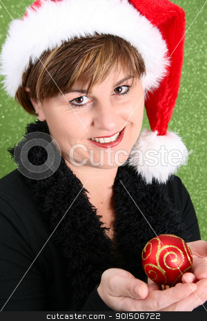 Christmas lady stock photo, Lady holding a christmas decoration on green background by Vanessa Van Rensburg