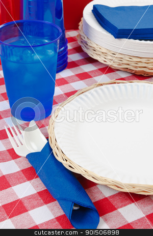 Red, White and Blue Picnic Table Setting stock photo, Red, white and blue picnic table setting is ready to celebrate  a festive summer holiday meal. by Karen Sarraga