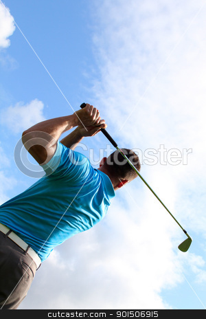 Young golfer stock photo, Young golfer hitting a shot with an iron by Vanessa Van Rensburg