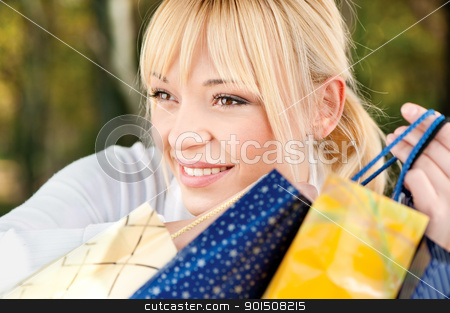 blond with shopping bags stock photo, Beautiful young blond with shopping bags, outdoor by iMarin
