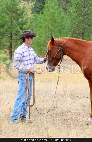 Cowboy stock photo, Young cowboy touching his horse on his nose by Vanessa Van Rensburg