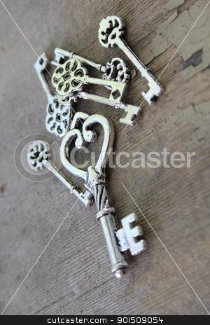 Miniature keys stock photo, Miniature antique keys on a wooden surface by Vanessa Van Rensburg