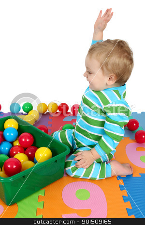 Toddler fun stock photo, Cute blond toddler playing on a number mat with balls by Vanessa Van Rensburg