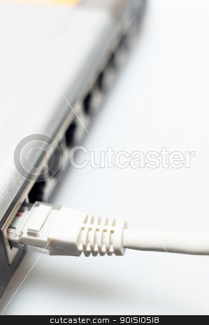 network hub switch with lan cable connected stock photo, network hub switch with lan cable connected over white by Francesco Perre