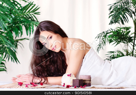 woman on the massage table stock photo, Pretty woman on the massage table for a spa treatment by iMarin
