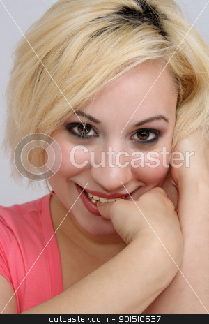 Shy, Timid Blonde stock photo, A studio close-up of a beautiful young blonde with a shy or timid facial expression. by Carl Stewart