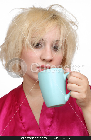 Grumpy Blonde Drinking Coffee (1) stock photo, A disheveled blonde wearing a bathrobe, about to take a sip of coffee. by Carl Stewart