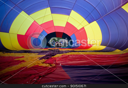 Inflating Hot Air Balloon stock photo, Observers watch ground crew inflate a hot air balloon by Bryan Mullennix