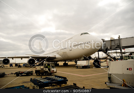 Plane in airport stock photo, Air travel - A parked plane is loading off Passengers in an airport by Lars Christensen
