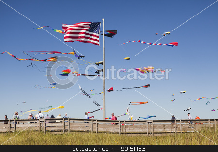 Kites and beach boardwalk stock photo, LONG BEACH, WASHINGTON, USA - AUGUST 20:  Visitors stroll the boardwalk during the International Kite Festival August 20, 2011.  The annual event draws kite enthusiasts from around the world. by Bryan Mullennix