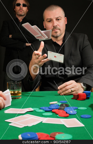 Card player throwing in his hand stock photo, Photo of a poker player throwing in his cards. by © Ron Sumners