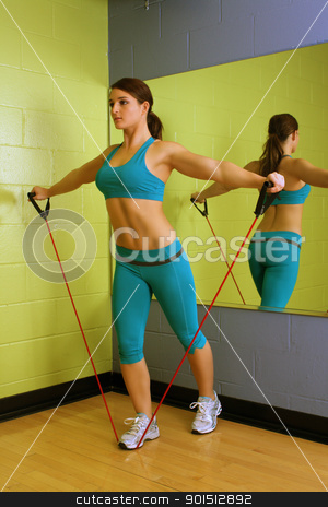Beautiful Woman with Resistance Band (4) stock photo, A lovely young brunette with exceptional muscle tone works out with resistance bands in front of a mirror. by Carl Stewart