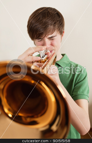 Teen playing gold trumpet stock photo, Photo of a young teen playing his gold trumpet. by © Ron Sumners