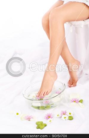 Slim legs of beautiful girl stock photo, Slim legs of beautiful girl with aromatherapy bowl  by iMarin