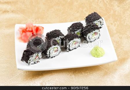 tuna sushi roll stock photo, sushi roll with tuna, avacado, sauce and flying fish roe by olinchuk