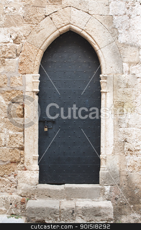 Old black medieval door with sliding door bolt stock photo, Old black wooden medieval door on limestone wall with antique sliding door bolt and padlock. by Brigida Soriano