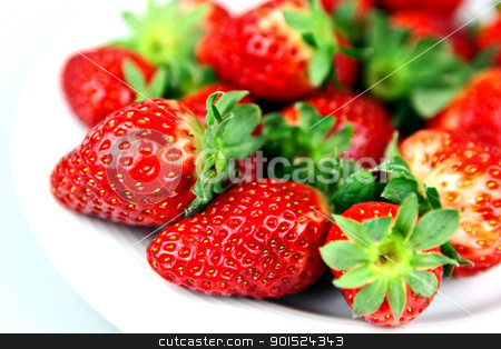 Freshly-picked strawberries stock photo, Freshly-picked strawberries from a farm sit in a pile. by Nenov Brothers Images