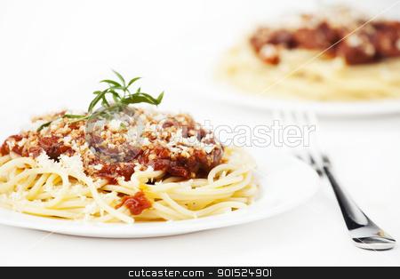 Pasta with tomato sauce stock photo, Italian pasta with tomato sauce on white by Vladimir Gladcov