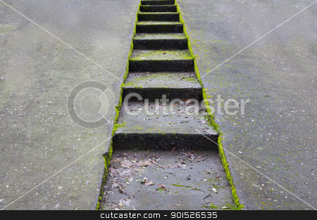 Concrete driveway and stairway stock photo, Green moss encrusted concrete driveway with sunken stairway by bobkeenan