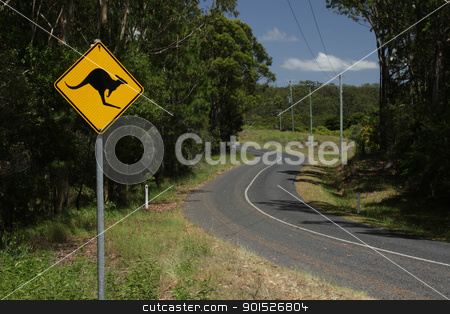 Country road in Australia stock photo, A road sign warning against cangaroos on a country road in Queensland, Australia. by DirkR