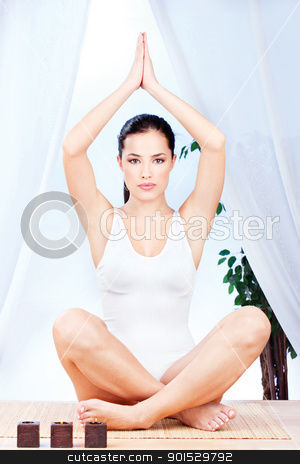 woman at yoga relaxation stock photo, Young pretty woman at yoga relaxation by iMarin
