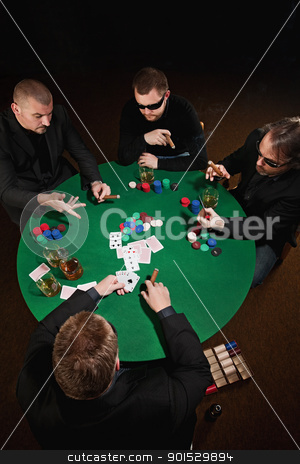 Card game stock photo, Photo of four men playing poker, smoking cigars and drinking whiskey. by © Ron Sumners