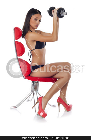 Sexy Fitness woman training with dumbbells  stock photo, Beautiful woman sitting on red chair and training with dumbbells  by Adam Radosavljevic