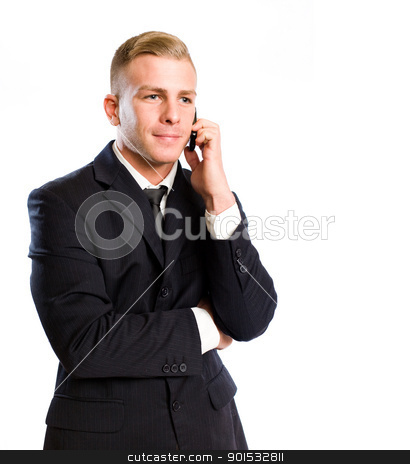 Busy on the phone. stock photo, Portrait of a handsome young businesman being busy on the phone. by exvivo