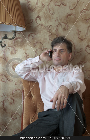 Telephone conversation stock photo, Portrait of middle-aged men talking on the telephone at home by Artamonov Yury
